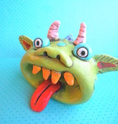 Rainbow Monster with an Open Mouth Original Folk Art sculpture. $18.00, via Etsy.
