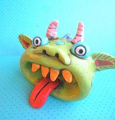 Rainbow Monster with an Open Mouth Original Folk Art sculpture. $18.00, via Etsy.
