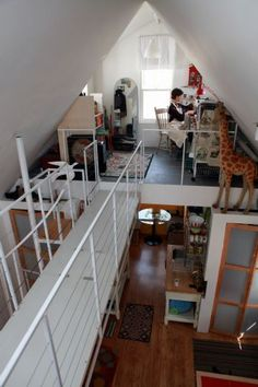 Catwalk between lofts Roger Schroeder and Michele Costa's 630 sq ft cottage in Buffalo, New York