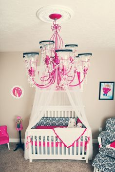 So lovely! Love love the canopy over the crib.