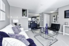 A quality home builder with 35 years of experience through our parent company Shane Homes. Currently building in the finest communities throughout Calgary and Airdrie. Visit our new communities, showhomes, new homes, quick possession homes and more. New Community, Home Builders, Corner Desk, Family Room, New Homes, Living Room, Building, Furniture, Home Decor