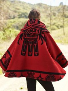 """LINDSEY THORNBURG RAVEN TRENCH CLOAK. The central design of our Raven blanket lends graphic impact to the back of the Raven Trench Cloak. It's a high style conversation starter that also will keep you warm through the coldest winter. Several years ago clothing designer Lindsey Thornburg made her first cape from a vintage Pendleton blanket given to her by her grandfather."""