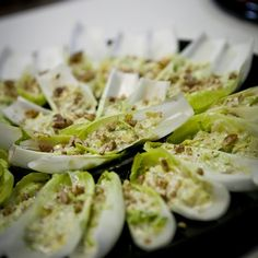 Caesar Salad served on endive leaves ready to be plated. Catering Events, Hors D'oeuvres, Caesar Salad, Cocktail Recipes, Zucchini, Nom Nom, Summertime, Food Porn, Appetizers