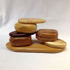 Handcrafted band sawn, sculpted wood keepsake or jewelry box designed to look like a pile of rocks with three drawers. by SolsWoodworkingShop on Etsy