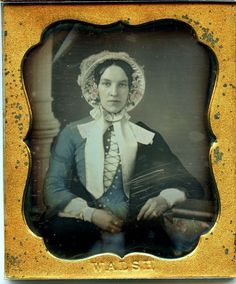 A 1/6 plate daguerreotype by Walsh of a stylish young woman in a fashionable blue dress and bonnet with tinted flowers. The photographer name is stamped on the mat. The image is in nice condition except there are some scratches just above her hand and a few marks around the perimeter of the plate. | eBay!