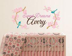 Cherry blossom branch with name, Blossom branch with birds, Blossom monogram nursery vinyl wall decal. $35.00, via Etsy.