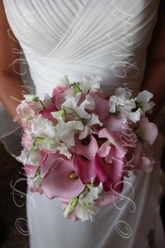 WEDDING BOUQUET DETAIL WITH SWEET PEAS AT KATHRYN'S WEDDING AT MATFEN HALL IN NORTHUMBERLAND