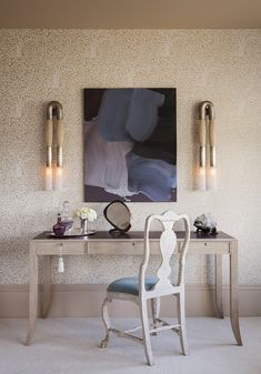 Feminine vanity with abstract art and white chair