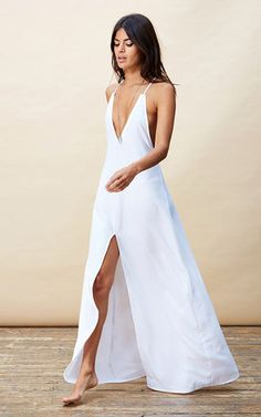 A very chic summer dress with deep V, cross detail at the back and thigh high split to front