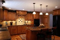 Tuscan Kitchen Design - with black appliances