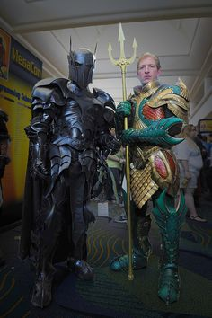 Medieval Batman & Aquaman by =Azmal. The armor is made out of hardened leather, so while it's bulkier than what would be appropriate in a real battle, it's still comfortable to wear. Aquaman's colors look gorgeous when presented this way. The scalemail is inspired. Batman's helmet has an appropriate Templar vibe.