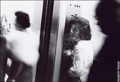 "Robert Frank, Elevator - Miami Beach. ""And I say: That little elevator girl looking up sighing in an elevator full of blurred demons, what's her name & address?"" - Jack Kerouac, Introduction, The Americans."
