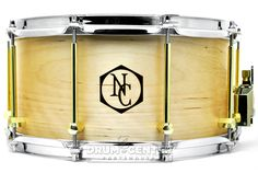 """Noble And Cooley Solid Ply Birch Snare Drum 14x7 Oil/Brass w/ Burned Logo BIRCH: Solid birch is known for its cutting attack and warm yet shortened sustain. It yields more of a """"pop"""" than a """"crack"""" (more closely associated with maple), and it fits well into any musical situation. Purchase Here: http://www.drumcenternh.com/noble-and-cooley-solid-ply-birch-snare-drum-14x7-oil-brass-w-burned-logo.html"""