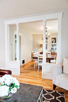Nicole Curtis removed the old carpet to reveal beautiful original pine floors. The refinished floors plus new furnishings work together to make the living and dining rooms comfortable, functional and stylish.