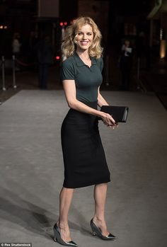 Sophisticated:Eva Herzigova showed off her lithe frame with a top tucked into her pencil skirt at theLondon premiere of A Bigger Splash on October 21, 2015