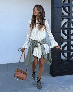 Everything about this outfit is great and check out those boots! TULAROSA dress