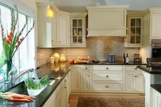 Uba Tuba granite countertops are popular due to the affordable price. Ubatuba is quarried in Brazil mostly. It is also called Verde Ubatuba, Green Labrador. Cream Kitchen Cupboards, Granite Kitchen, Kitchen Redo, Home Decor Kitchen, New Kitchen, Kitchen Ideas, Kitchen Photos, Beige Kitchen, Kitchen Facelift