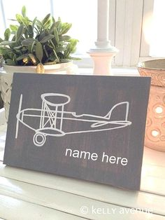 Lets fly away! This hand painted airplane sign is perfect for a boys aviation room, office, or man cave! Personalize the painting with a name or date