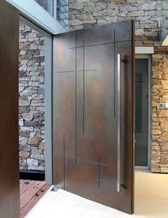 Idee porte blindate moderne - design portone d'ingresso minimal, realizzato in metallo/bronzo - Guida alla scelta: materiali, classi, idee e prezzi porte blindate