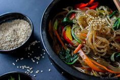 A springy & chewy Korean glass noodle recipe (chapchae/japchae) seasoned lightly with sweet soy sauce, sesame oil and a variety of vegetables using a simple fool-proof way of getting springy noodles without boiling them!