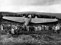 Villagers from Humbie, in East Lothian, gather to inspect the wreckage of a Luftwaffe Heinkel He111 (1939)