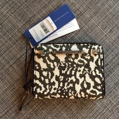 "Rebecca Minkoff Mini Ava Zip Wallet Sold out online! Style sc34espc02. From web: This small textured leather wallet fits all your cards, but won't weigh you down. It's cute compact size is ideal for the girl on the go. 4.75""W x 4""H x 1""D. Genuine leather. Custom silver hardware. Zipper closure. Three interior compartments. Two interior slip pockets. Lined. Rebecca Minkoff Bags Wallets"
