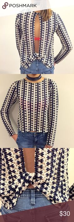 """[zara] open-back knit top in navy Fun, open-back top to wear w jeans. The cool back makes this top, although you will get plenty of compliments on the gorgeous knit pattern too  18"""" shoulder to hem; 15"""" pit to pit. 100% poly. Relaxed fit. Excellent condition Zara Tops"""