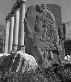 High relief (private collection) photographed in front of the Hadrian's Library, Athens, Greece (1937.)      Photo by Herbert List