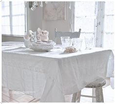 """But Ashwell's heart remains loyal to flea market finds and says their authenticity is """"hard to duplicate without true living and loving."""" We're loving her antique table and chandelier in her pristine dining room.   - HouseBeautiful.com"""