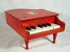 miniature piano...I'd forgotten all about having one of these until I saw it on someone else's board.