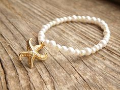 Check out this item in my Etsy shop https://www.etsy.com/listing/224993232/starfish-pearl-bracelet-starfish