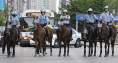 .Chicago police department mounted patrol monitors the area.