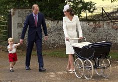 George again clutches his father's hand as the family left church and made their way back to the main Sandringham property on foot