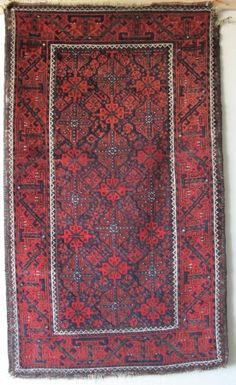 Baluch Rug with Floating Chemches. Saturated soft wool with all natural colors. Good color shift from vibrant madder red to rust-orange at the top third. Slightly sculptural affect. Asymmetrically knotted open right. Good condition, sides intact but damaged at top right-hand corner