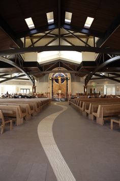 OUR LADY OF MT. CARMEL CATHOLIC CHURCH | rancho peñasquitos, san diego. elevated roof. copper clad dome. steel trusses to span large worship space. custom altar, tabernacle, and reredos.