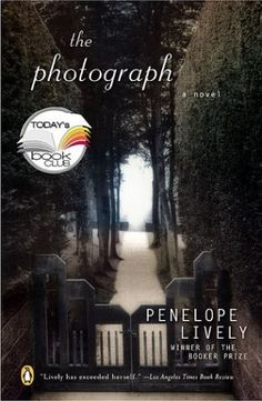 The Photograph by Penelope Lively: http://www.amazon.com/gp/product/0142004421?ie=UTF8&camp=1789&creativeASIN=0142004421&linkCode=xm2&tag=thereadingcov-20