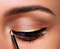 Gold + black posh eyeliner.