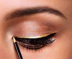 Gold + black posh eyeliner.