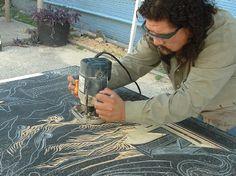 San Antonio artist Alex Rubio works on a large scale woodcut project.  -  contemporaryartmonth.com
