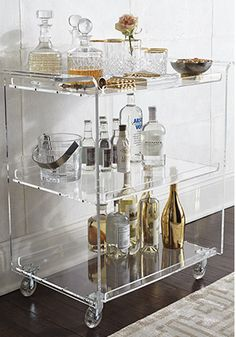 I am totally loving the bar cart trend right now. It is such a chic and retro way to decorate your home. Not only does it work as a decor piece, but it's also practical as well, storing your most used bar items. Check out my tips on how to start your own Home Bar Decor, Bar Cart Decor, Retro Home Decor, Vintage Decor, Vintage Style, Mini Bars, Acrylic Furniture, Plywood Furniture, Lucite Furniture