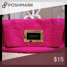 Victoria's Secret clutch/purse Very cute clutch by VS.  Hot pink inside and out.  Only one pocket but can be accessed by a zipper on the back or lifting the main flap.  Perfect for a night out with the girls. Victoria's Secret Bags Clutches & Wristlets