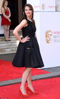 Coronation Street star Kate Ford (pictured) has been blasted after taking a 'dangerous' photo from behind the wheel of her car while taking her son to school