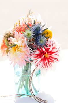 Arrangement from an October 2011 beach wedding. Dahlias, garden roses, proteas, thistles, etc. @Primary Petals {Samantha}