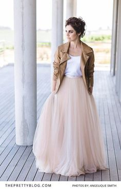 Light pink wedding dress paired with tan leather jacket | Photograph by Angelique Smith | Dress by Janita Toerien |