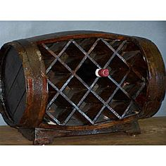 @Overstock - Keep your favorite bottles on hand with this rustic barrow wine rack  Wine rack features a unique design made from a solid wood barrel  Storage rack holds up to 11 bottles of wine http://www.overstock.com/Home-Garden/Wood-Stained-Barrow-Wine-Rack/4389443/product.html?CID=214117 $197.99
