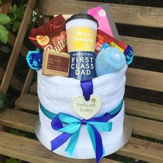 Want to treat a man to a gorgeous thoughtful gift that is totally unique? This towel cake gift set is very unique and includes some lovely items for him to Gift Hampers, Gift Baskets, Pamper Cake, Wine Gums, Father's Day Celebration, Mens Soap, Towel Cakes, New Daddy, Breakfast Tea