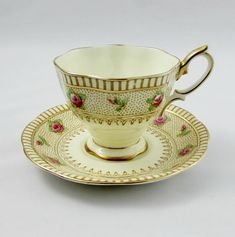 Beautiful bone china tea cup and saucer made by Royal Albert with small hand painted roses. Gold trimming on cup and saucer edges, as well as on tea cup handle. Excellent condition (see photos). The markings read: Royal Albert Crown China England Please bear in mind that these are