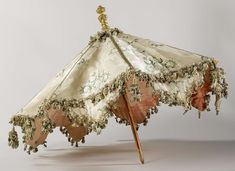 Parasol: ca. 1690-1710, with a deck of brocaded silk on a frame and stick with handle of wood, painted and gilded.
