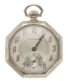 Waltham 14k Gold 17 Jewel Pocket Watch Case: 14k white gold, octagon 12 size, engraved birds on the back cover, small monogram in the crest on the back cover, snap back Dial: two-tone metal, gold Arabic, purple kite hands Movement: 17 jewel, nickel, 3/4 plate, gold jewel settings, adjusted to temperature, jeweled Main Wheel, checker board damaskeened