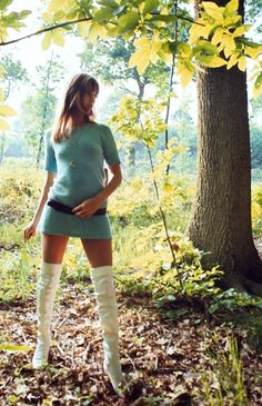 Jane Birkin wearing white thigh high boots, photographed in the forest of Rambouillet, 1969